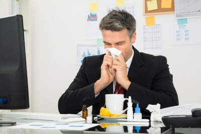 Man blowing his nose in the office is the reason offices should have professional cleaning