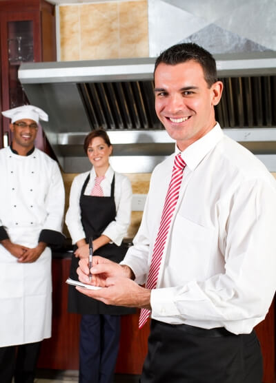 Happy restaurant manager with cleaning company