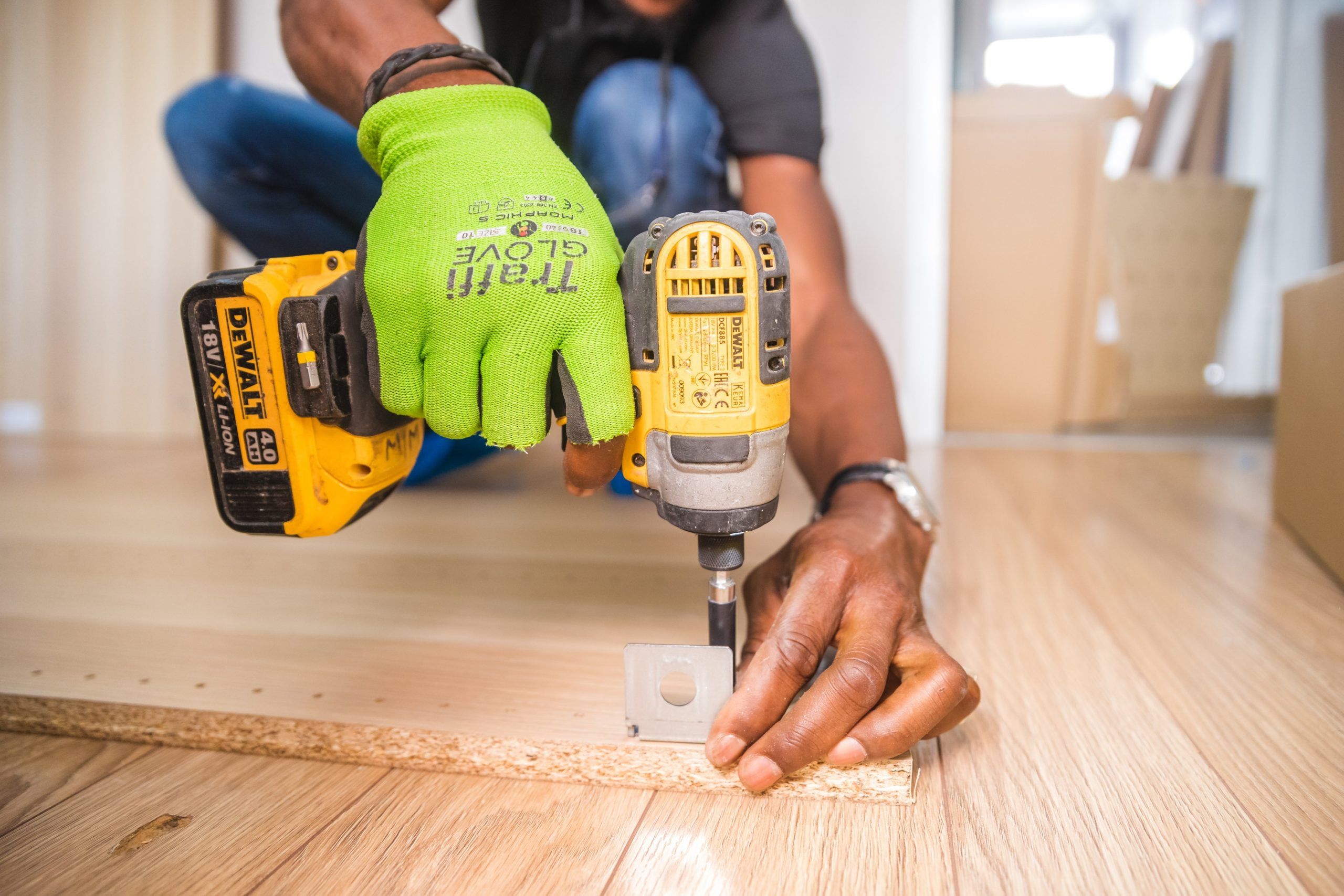 Man with power drill at construction site